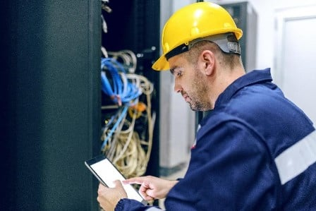 Technologist checking wiring diagram