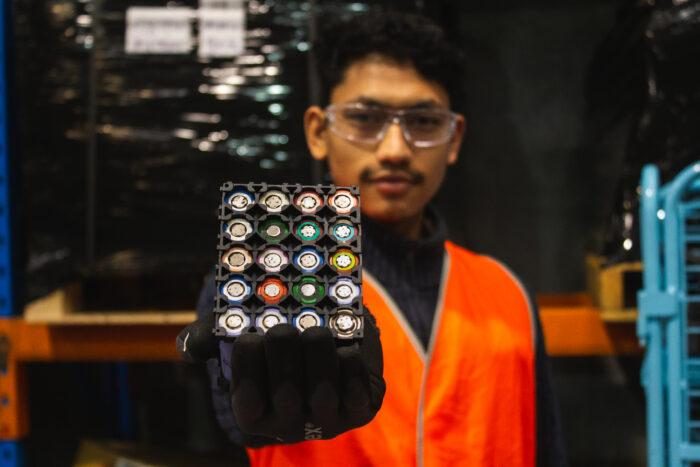 EIT student holding lithium-ion batteries